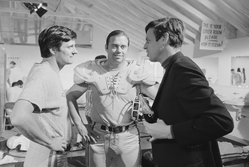 Author George Plimpton confers with Alan Alda on the set of the 1968 comedy Paper Lion, a film adaptation of Plimpton's best-selling book. (Bettmann/Getty Images)