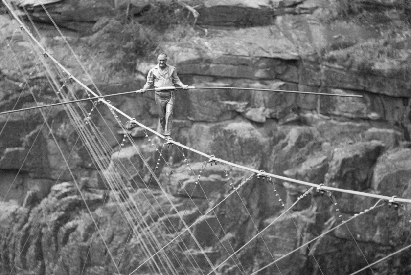 Karl Wallenda, patriarch of the Flying Wallendas tightrope troupe, walks a tightrope across the Tallulah Gorge, as an audience of 35,000 look on. (Bettmann / Contributor)