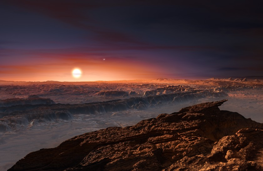 A hand out image made available by the European Southern Observatory on August 24 2016, shows an artist's impression of a view of the surface of the planet Proxima b orbiting the red dwarf star Proxima Centauri, the closest star to the Solar System. (M. KORNMESSER/AFP/Getty Images)