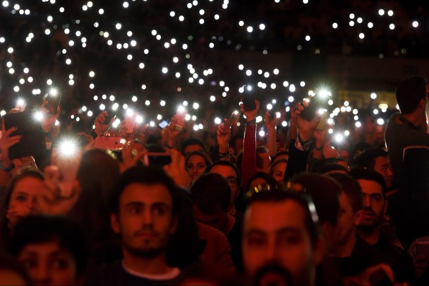 Web Summit's attendees light up the flash lights of their phones at the main stage during the Web Summit at Parque das Nacoes, in Lisbon on November 9, 2016. Europe's largest tech event Web Summit will be held at Parque das Nacoes in Lisbon from November 7 to 10, 2016. (Patricia De Melo Moriera/AFP/Getty Images)