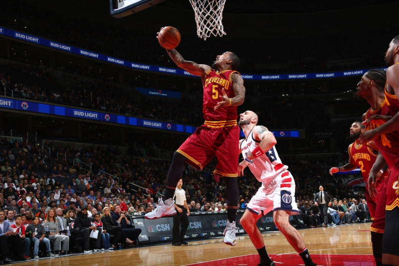 J.R. Smith #5 of the Cleveland Cavaliers goes for the rebound during the game against the Washington Wizards (Ned Dishman/NBAE via Getty Images)