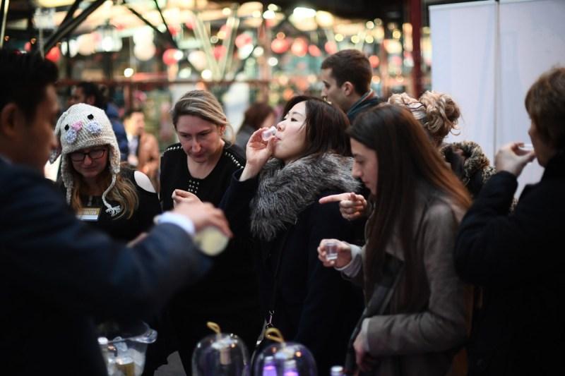 Visitors sample sake at the Hyper Japan Christmas Market on November 25, 2016 in London, England (Carl Court/Getty Images)