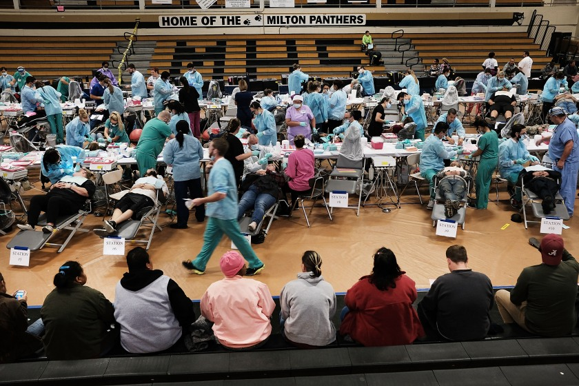 People wait to see a dentist at the Remote Area Medical (RAM) mobile dental and medical clinic on December 3, 2016 in Milton, Florida. (Spencer Platt/Getty Images)