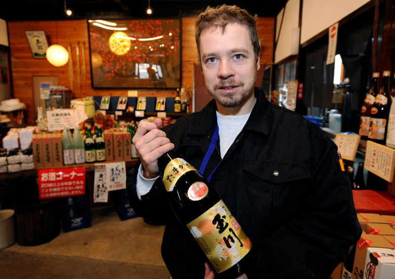 Master sake brewer Philip Harper from the United Kingdom holds a bottle of sake at the Tamagawa Sake Brewery in Kyoto, Japan (Robert Gilhooly/Bloomberg via Getty Images)