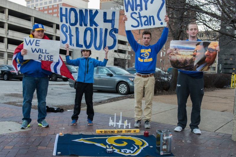 Football fans gather outside the Edward Jones Dome to protest the NFL's decision to allow Rams owner Stan Kroenke to move the team to Los Angeles. (Photo by James A. Cooper/Corbis via Getty Images)