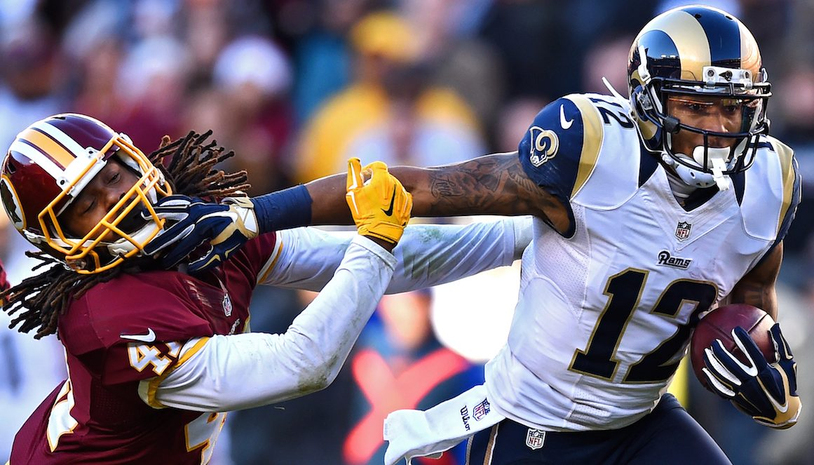 LANDOVER, MD - DECEMBER 07: Strong safety Phillip Thomas #41 of the Washington Redskins is stiff armed by wide receiver Stedman Bailey #12 of the St. Louis Rams in the third quarter of a game at FedExField on December 7, 2014 in Landover, Maryland. (Photo by Patrick Smith/Getty Images)