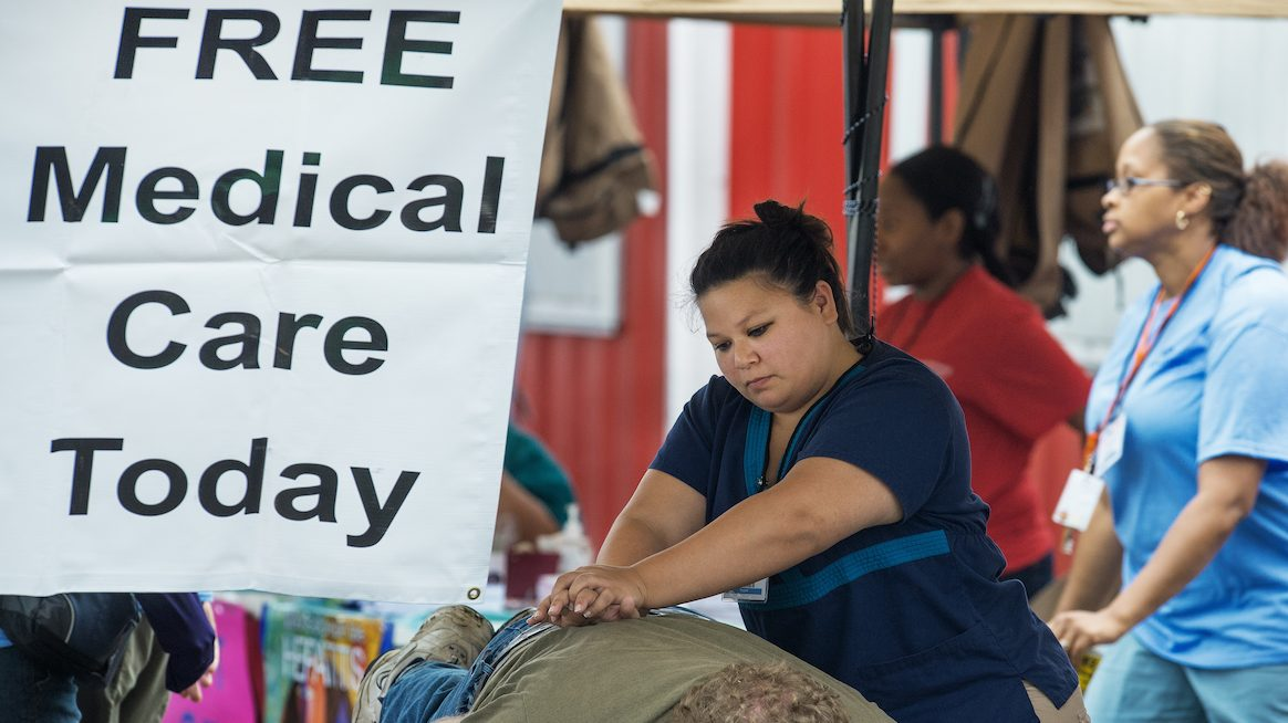 A patient receives treatment during the non-profit Remote Area Medical(RAM) clinic held at the county fairgrounds July 20 in Wise, Virginia. (AFP Photo/Paul J. Richards/GettyImages)