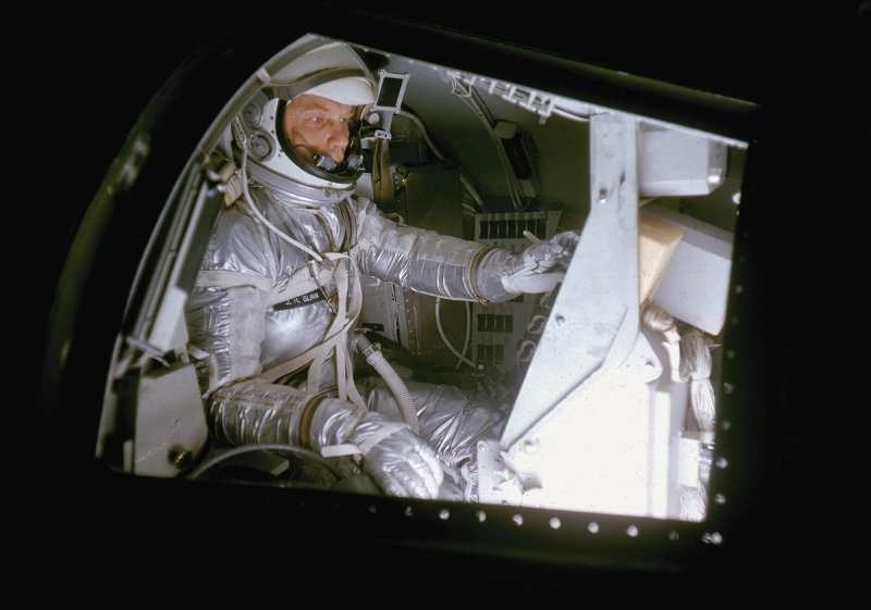 American astronaut (and future politician) John Glenn practices, in a full flightsuit, in a mock Project Mercury space capsule, Langley Research Center, Virginia, 1959. (Photo by Ralph Morse/The LIFE Picture Collection/Getty Images)