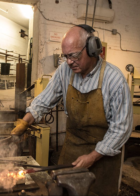 John Dittmeier, Blacksmith, performs a series of straightening and bending after using a power hammer. (April Greer/Washington Post/Getty Images)