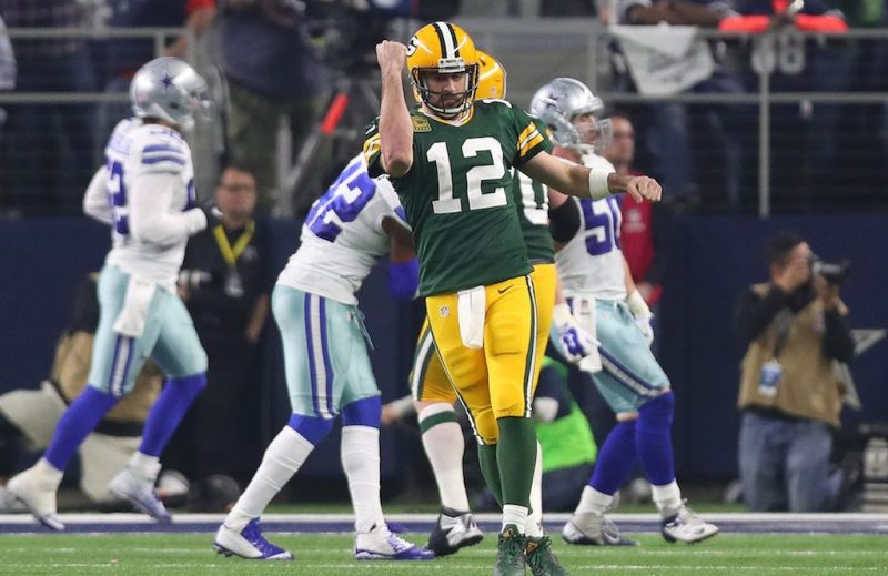 ARLINGTON, TX - JANUARY 15: Aaron Rodgers #12 of the Green Bay Packers celebrates after throwing a touchdown pass during the third quarter against the Dallas Cowboys in the NFC Divisional Playoff game at AT&T Stadium on January 15, 2017 in Arlington, Texas. (Photo by Tom Pennington/Getty Images)
