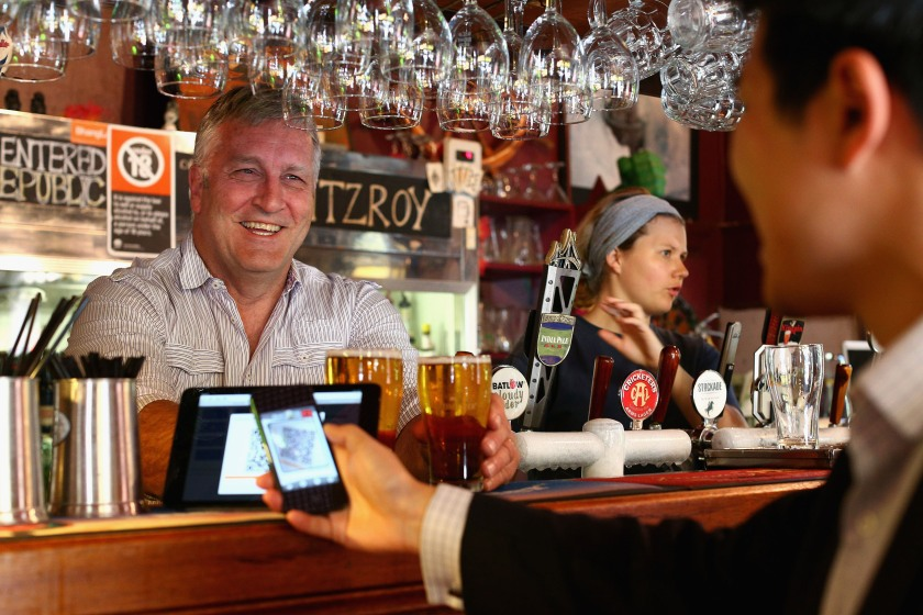 The Old Fitzroy Pub owner Garry Pasfield serves a customer using bitcoins on September 19, 2013 in Sydney, Australia. (Cameron Spencer/Getty Images)