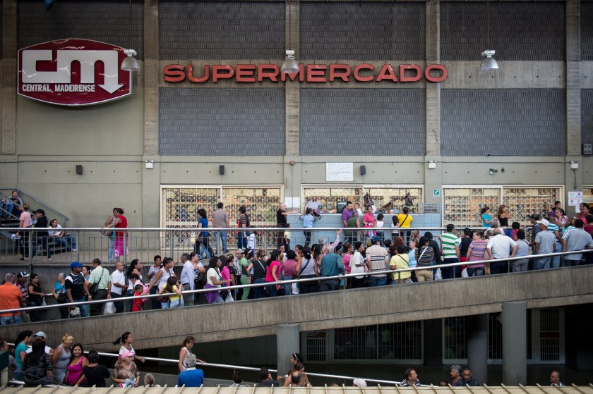 People queue up outside a supermarket in Caracas on January 13, 2015. (Federico Parra/AFP/Getty Images)