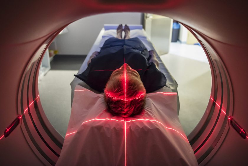 Person undergoing a CAT scan in hospital. PET scan equipment. (Getty Images)