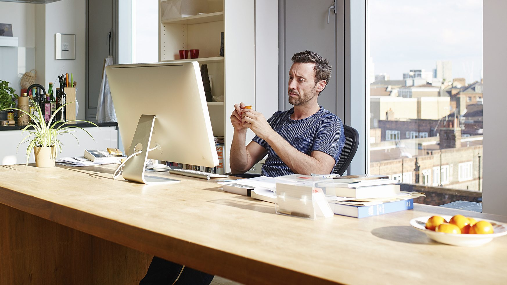 Man working alone in his apartment (Getty Images)