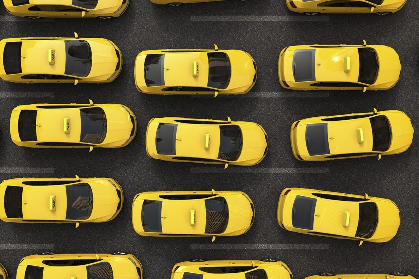 MIT's study explores replacing taxis with ride-sharing car services, like Uber or Lyft. (Jose Luis Stephens/Radius Images/Getty Images)