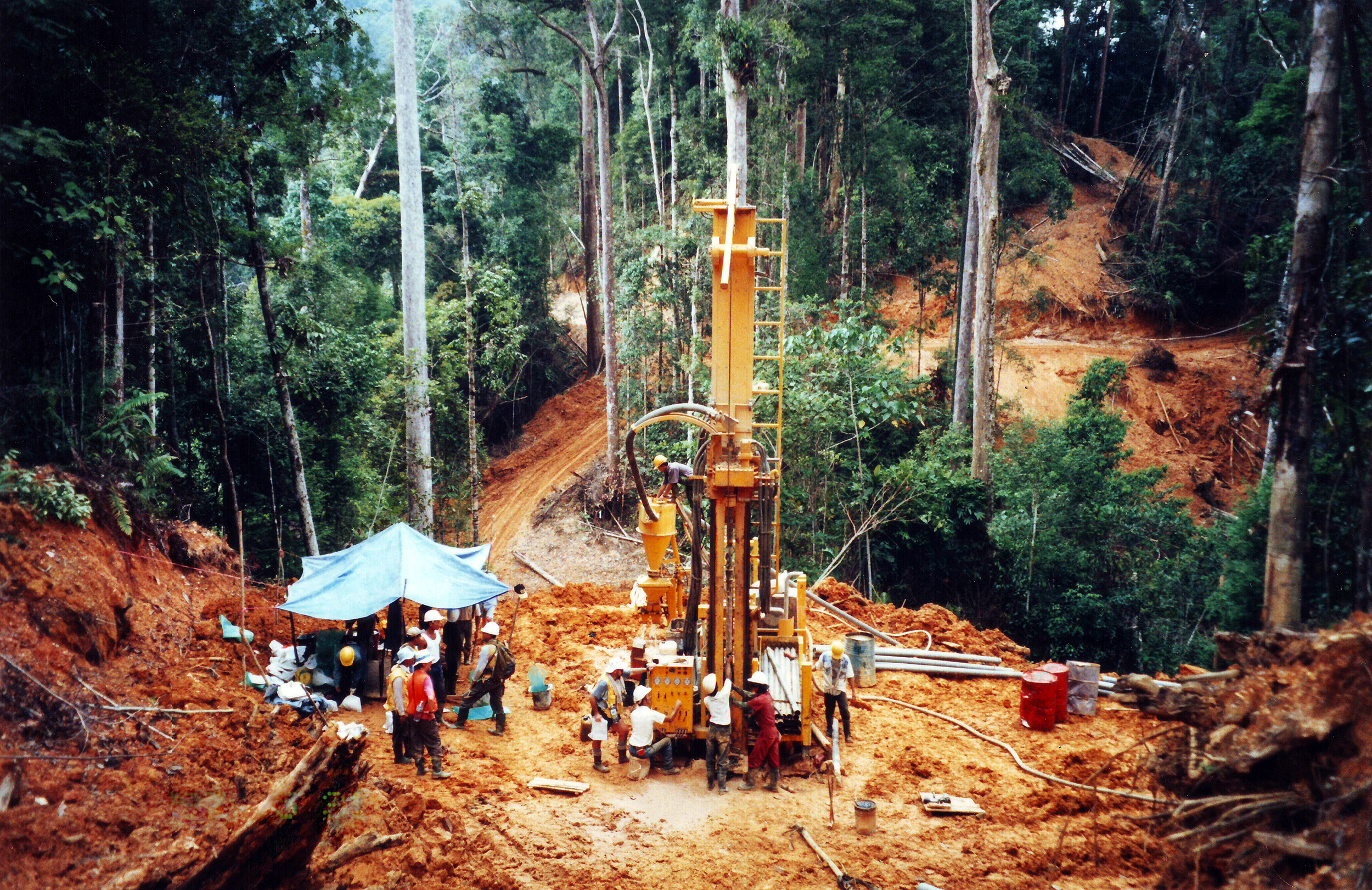 A drilling rig extracting drillcore to evaluate the economics of developing a potential gold mine deep in the Borneo jungle of Indonesia. (Getty Images)