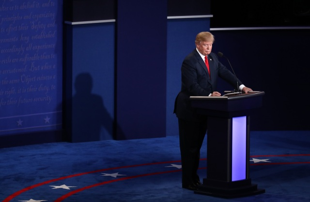 Donald Trump, 2016 Republican presidential nominee, writes notes during the third U.S. presidential debate in Las Vegas, Nevada, U.S., on Wednesday, Oct. 19, 2016. (Andrew Harrer/Bloomberg via Getty Images)