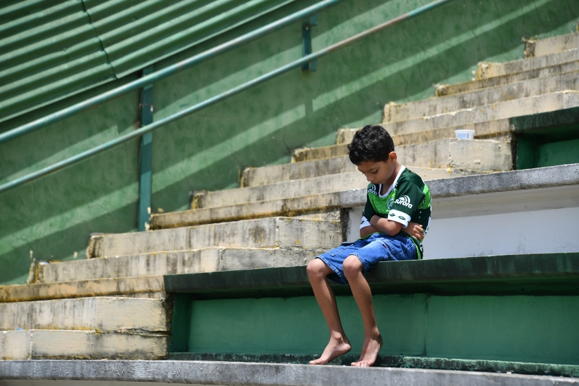 A boy sits alone on the stands during a tribute to the players of Brazilian team Chapecoense Real who were killed in a plane accident in the Colombian mountains, at the club's Arena Conda stadium in Chapeco, in the southern Brazilian state of Santa Catarina, on November 29, 2016. Chapecoense had risen from obscurity to make it to the Copa Sudamericana finals scheduled for Wednesday against Atletico Nacional of Colombia. (Nelson Almeida/AFP/Getty Images)