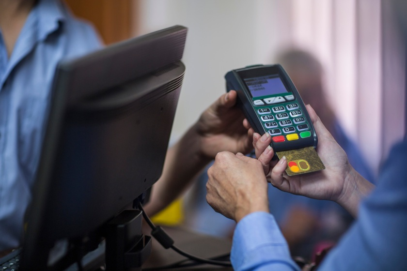 Cape Town, South Africa, customer using credit card reader at store (Getty Images)