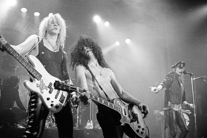 LOS ANGELES, CA - OCTOBER 27: Duff McKagan, Slash and Axl Rose of Guns 'n' Roses perform in concert at the Ritz on February 2, 1988 in New York City. (Photo by Larry Busacca/WireImage)