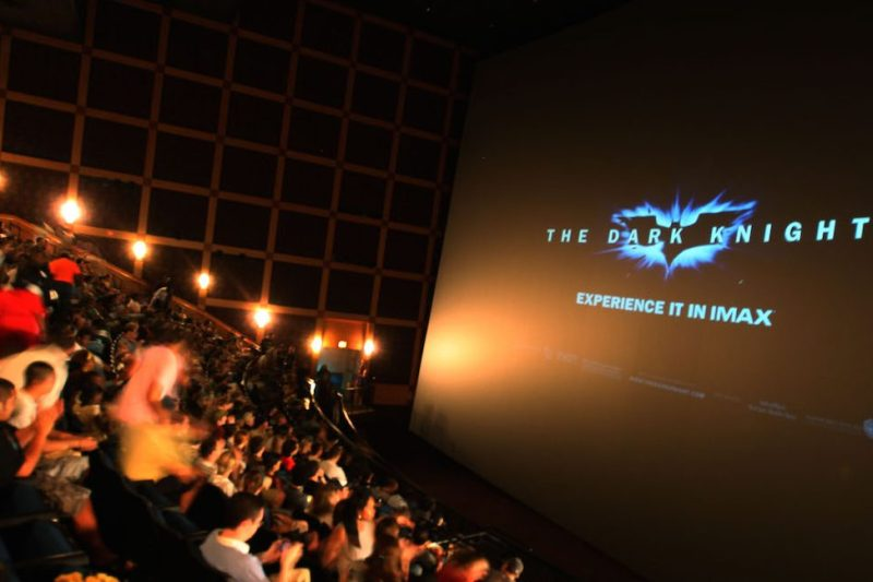 """CHICAGO - JULY 17: Members of the audience watch the """"The Dark Knight"""" Chicago midnight screening at the Navy Pier Imax Theater on July 17, 2008 in Chicago, Illinois. (Photo by Tasos Katopodis/Wireimage) *** Local Caption ***"""