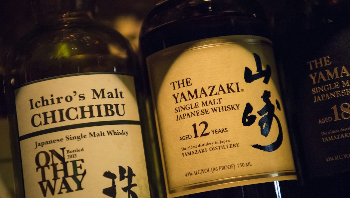 Bottles of Ichiro's Malt brand whisky and Yamazaki Distillery single malt whiskey stand on a shelf at the Nihon Whisky Lounge in San Francisco, California, U.S., on Tuesday, March 29, 2016. Malt imports in Japan jumped 20 percent last year and have almost quadrupled over the past decade, spurred by demand for Japanese whiskies from San Francisco to Hong Kong. Photographer: Photographer: David Paul Morris/Bloomberg