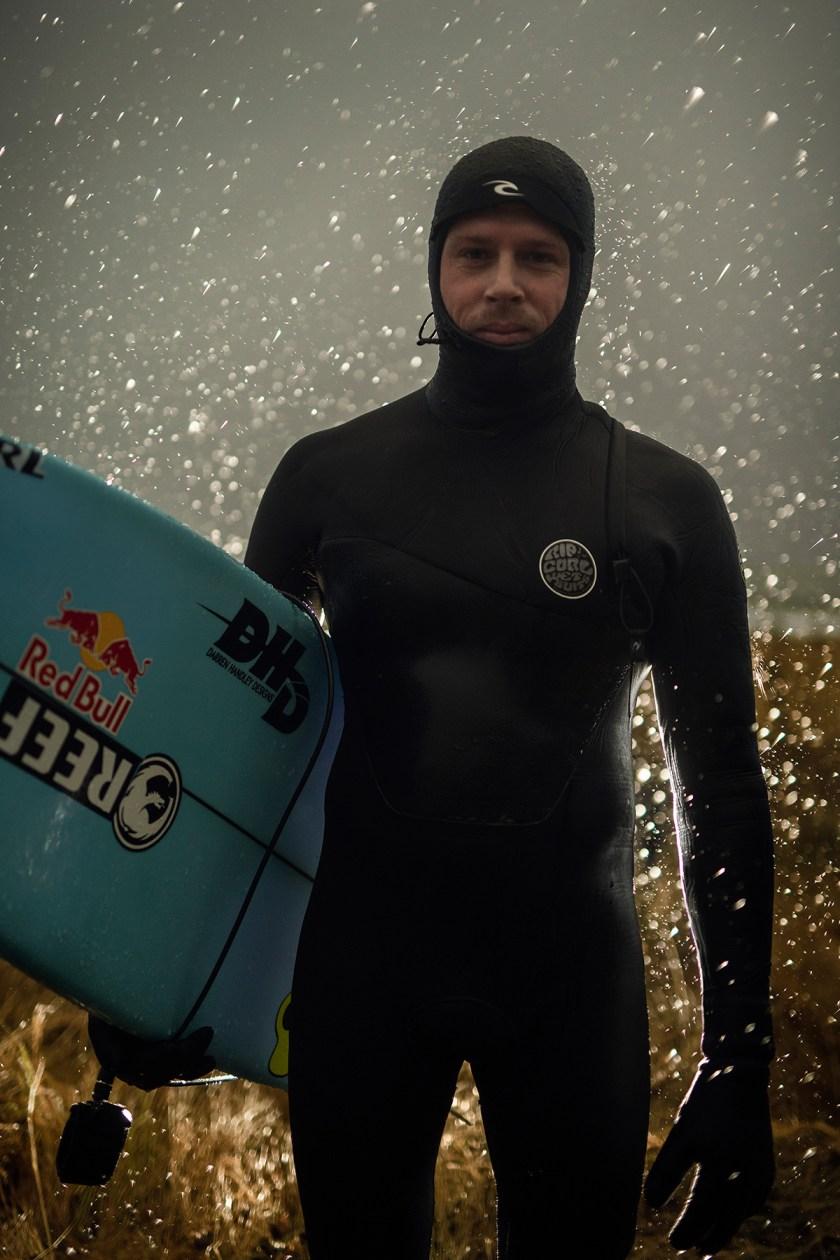 Surfer Surfing Under the Northern Lights