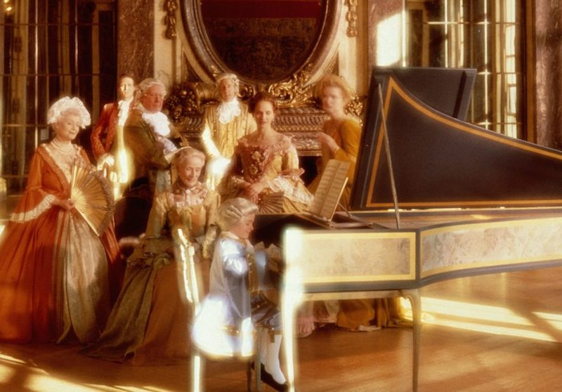 AMADEUS AT PIANO WITH ADMIRING ADULTS