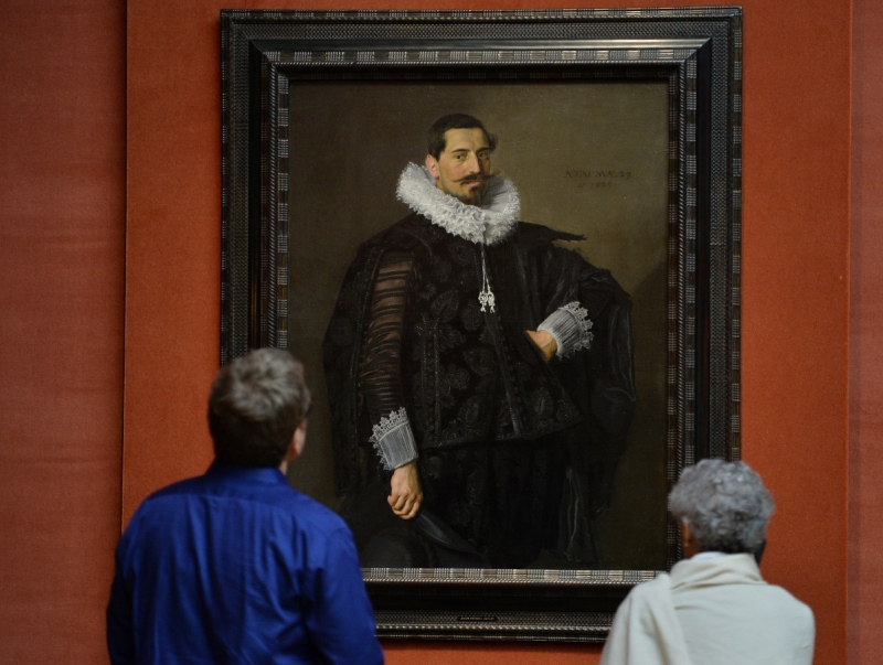 """Museum patrons look at Frans Hals' """"Portrait of Jacob Olycan"""" (Stan Honda/AFP/Getty Images)"""