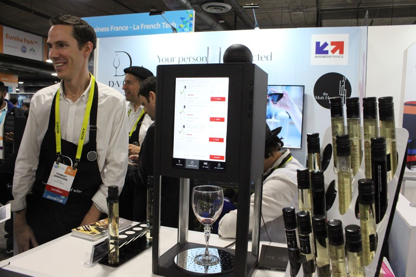 10 Vins co-founder Thibaut Jarrousse shows off the French startup's second-generation D-Vine tech 'sommelier' during the Consumer Electronics Show (CES) on January 7, 2017 in Las Vegas, Nevada. The swirl of technology at the Consumer Electronics Show seeped into all aspects of modern life, even happy hour. Those inspired to reach for a cocktail after navigating seemingly endless CES show floors packed with dizzying displays and throngs of gawkers and talkers were in luck... there were gadgets for that. (Glenn Chapman/AFP/Getty Images)