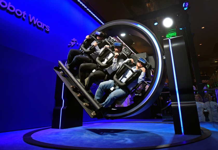 Attendees participate in a Samsung virtual reality ride at CES 2017 at the Las Vegas Convention Center on January 5, 2017 in Las Vegas, Nevada. CES, the world's largest annual consumer technology trade show, runs through January 8 and features 3,800 exhibitors showing off their latest products and services to more than 165,000 attendees. (David Becker/Getty Images)