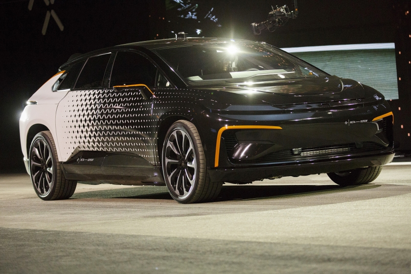 The Faraday Future FF91 electric car is unveiled at the 2017 Consumer Electronics Show (CES) in Las Vegas, Nevada, U.S., on Tuesday, Jan. 3, 2017. Faraday Future staked its claim to the world's fastest electric car with its FF91 production model, showing footage of it outracing Tesla Motors Inc.'s Model S in a glitzy event in Las Vegas. (Patrick T. Fallon/Bloomberg via Getty Images)