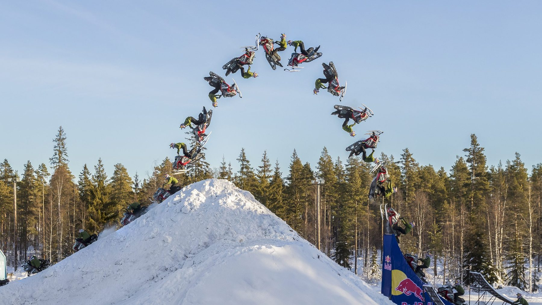 A photo compsite showing Daniel Bodin in various stages of completing the worlds first double backflip with a snowmobile. (Richard Ström/Red Bull Content Pool)