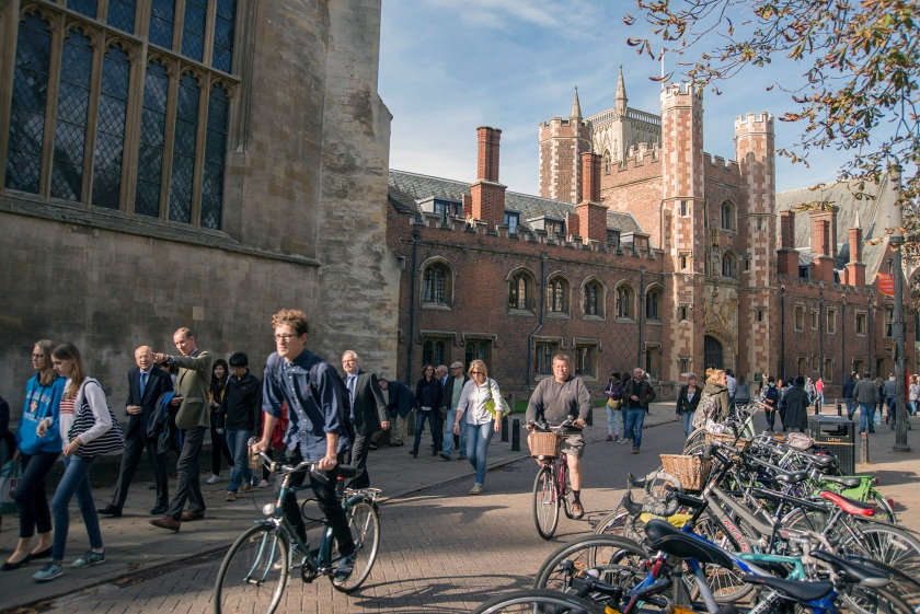 Cyclists and pedestrians move along Trinity Street past St Johns College, part of the University of Cambridge in Cambridge, U.K., on Sunday, Oct. 5, 2014. (Peter Kindersley/Bloomberg via Getty Images)