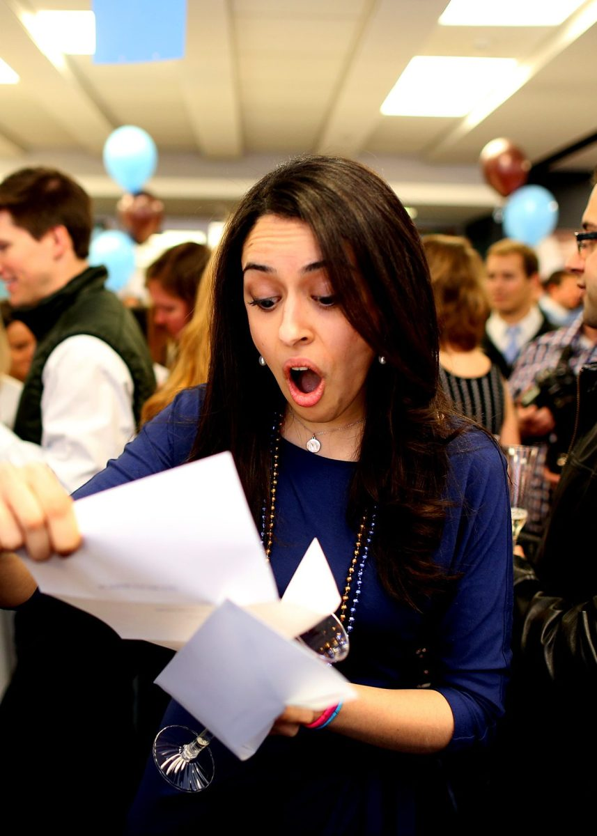 Fourth year medical students from Tufts University School of Medicine gather for what's known as Match Day to receive their envelopes telling them where they will do their residency training. Mina Khorashadi opens her acceptance letter, telling her she will be going to Stewart Carney Hospital for a one-year internship before moving to Anesthesiology at the University of California San Francisco. (Jonathan Wiggs/The Boston Globe via Getty Images)