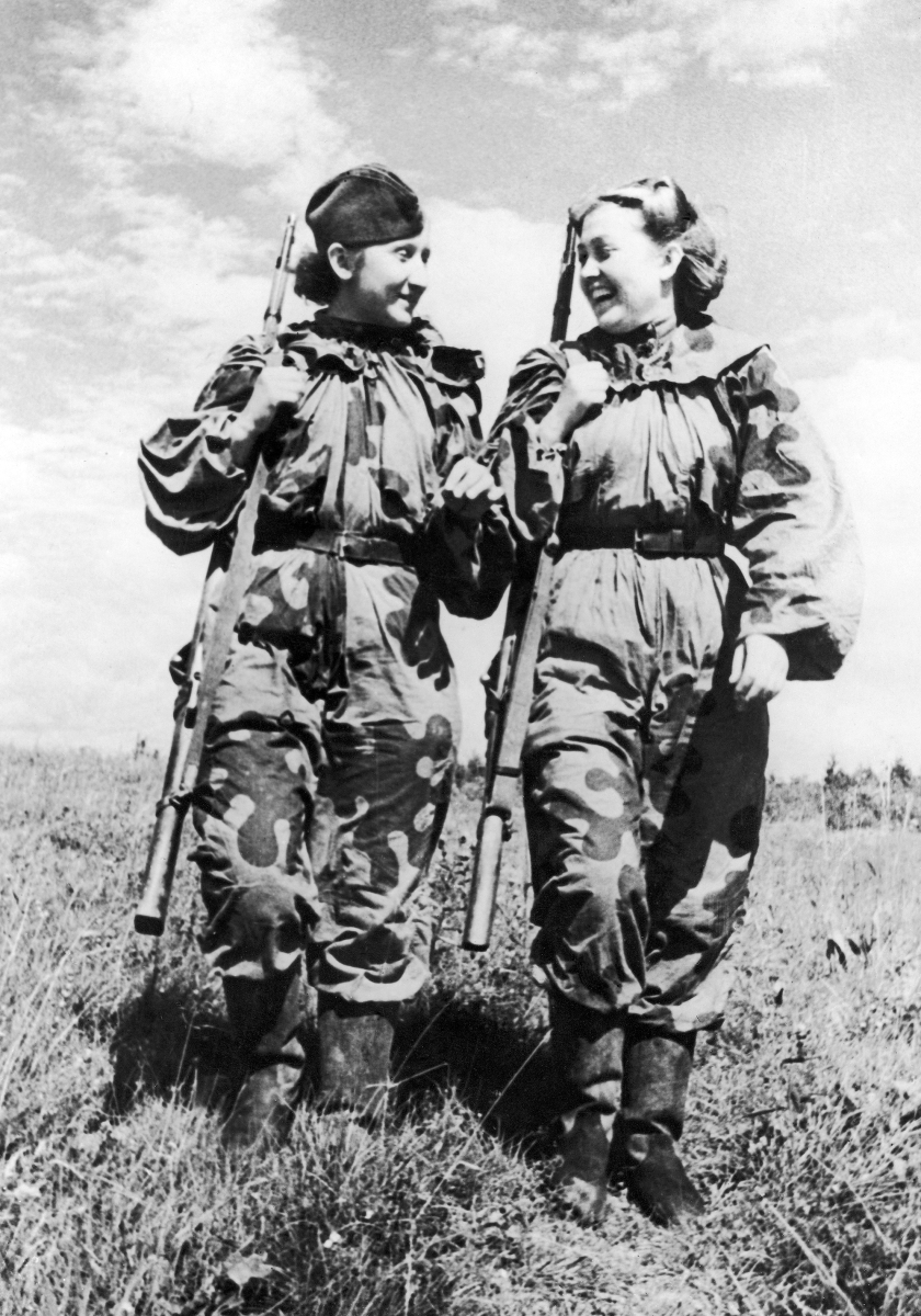 Volunteer women snipers of the Russian Army R. Skrypnikova (right) and O. Bykova returning from a combat assignment during the Second World War on November 21, 1943. (Daily Mirror Library/Mirrorpix/Mirrorpix via Getty Images)