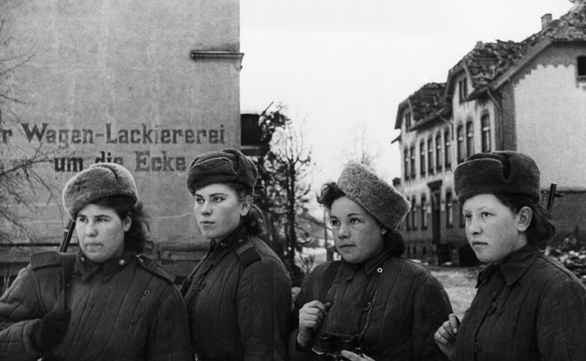A group of young women, Soviet snipers who have 2,000 German kills between them, inspecting a small town in East Prussia after it was taken by the Soviet Army, in February of 1945. (Sovfoto/UIG via Getty Images)