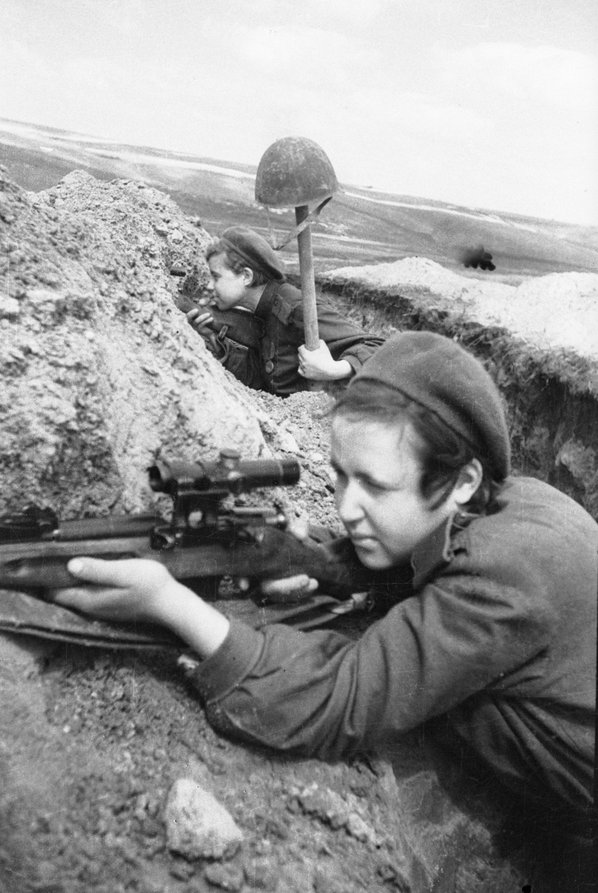 The Red Army Soviet snipers shooting from a trench in 1943. (Ozerksy/AFP/Getty Images)