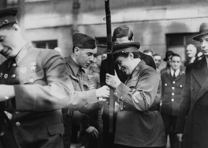 Sniper Lyudmilla Pavlichenko, a Soviet lieutenant, examines the rifle of a member of the Home Guards while on a trip to London with other young Soviets. She serves as a sniper in the Soviet army and has shot 309 Germans. (Hulton-Deutsch Collection/Corbis via Getty Images)