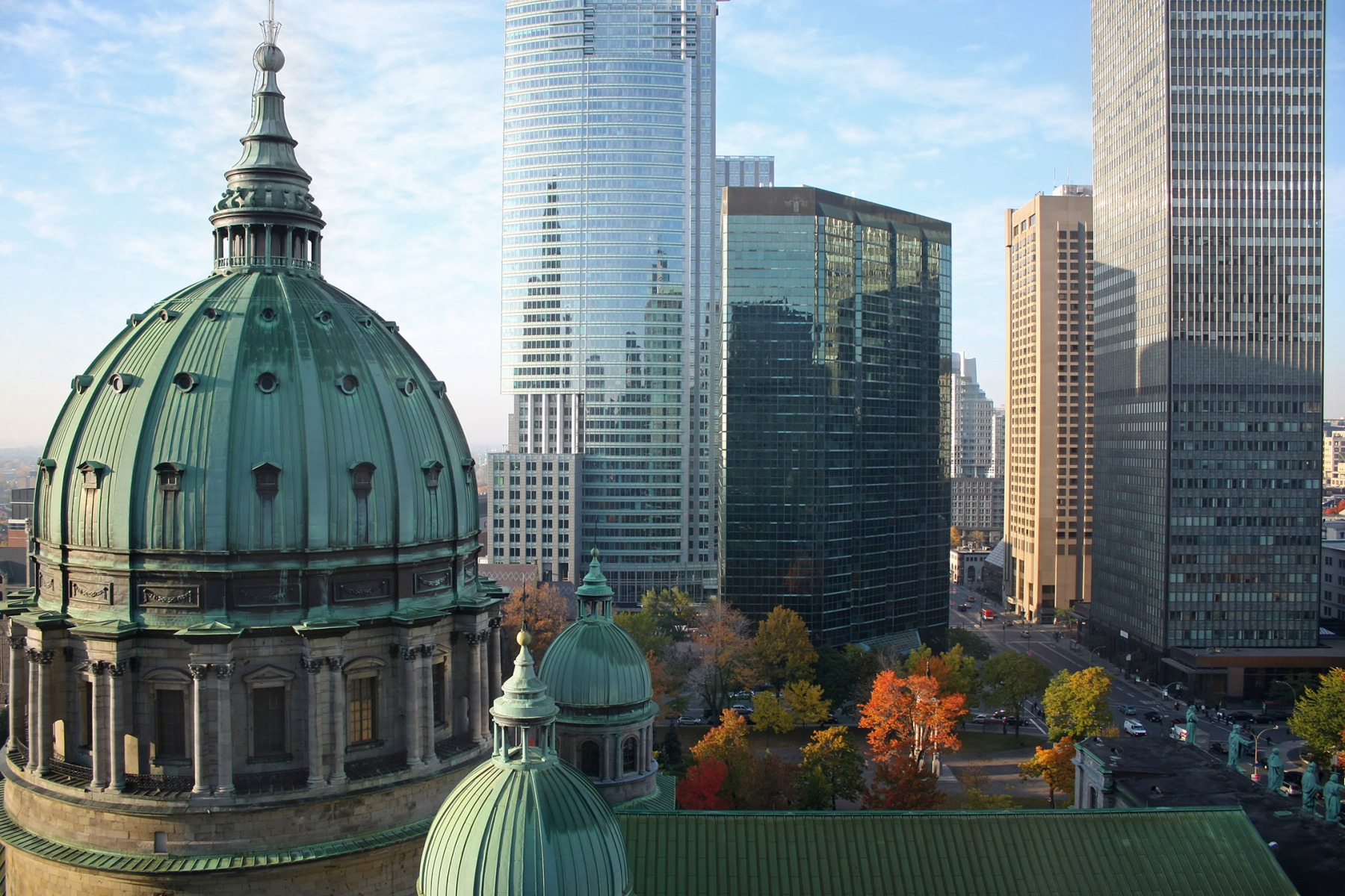 "Autumn picture of the dome of the ""Cathedrale Marie-Reine-du-monde"" and modern highrise office buildings in Montreal, Canada. (Getty Images)"