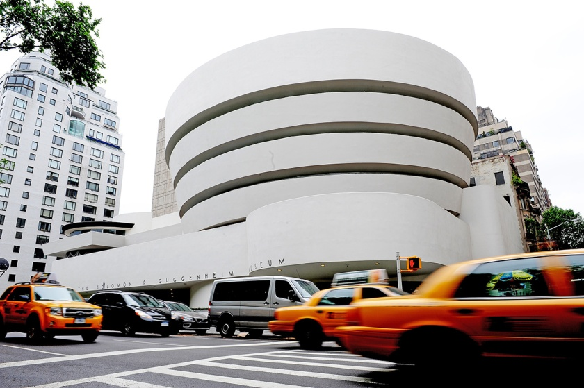 """An exterior view along Fifth Avenue May 14, 2009 of the Guggenheim Museum in New York as the museum marks its 50th anniversary with an exhibition """"Frank Lloyd Wright: From Within Outward"""". The building itself was designed by Wright. AFP PHOTO/Stan Honda (Photo credit should read STAN HONDA/AFP/Getty Images)"""