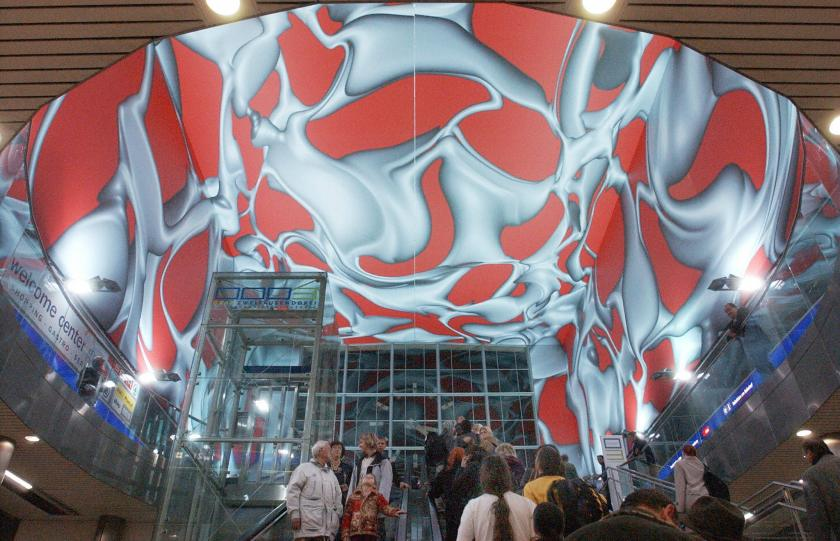 Visitors go into the arrival hall of the newly renovated railway station where painting by Peter Kogler are exhibited in Graz 9 October 2003. (Joe Klamar/AFP/Getty Images)