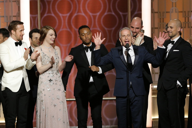"""BEVERLY HILLS, CA - JANUARY 08: In this handout photo provided by NBCUniversal, (L-R) actors Ryan Gosling, Emma Stone and John Legend and producers Marc Platt, Jordan Horowitz and Fred Berger accept the award for Best Motion Picture - Musical or Comedy for """"La La Land"""" onstage during the 74th Annual Golden Globe Awards at The Beverly Hilton Hotel on January 8, 2017 in Beverly Hills, California. (Photo by Paul Drinkwater/NBCUniversal via Getty Images)"""