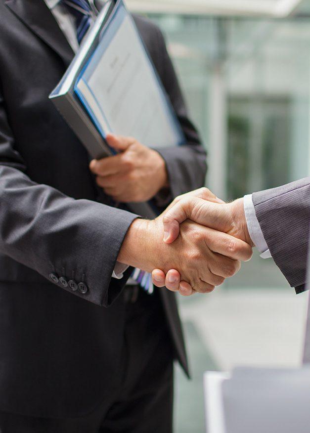 Businessmen shaking hands (Getty Images)