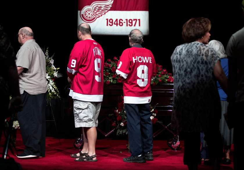 """Mourners and NHL fans pay their respects to legendary hockey Hall of Famer Gordie Howe at his visitation at Joe Louis Arena June 14, 2016 in Detroit Michigan. Howe, known as """"Mr. Hockey"""", played for the Detroit Red Wings for 25 years, and scored 801 goals in his career. His funeral service will be held tomorrow, June 15, at the Cathedral of the Most Blessed Sacrament in Detroit. (Bill Pugliano/Getty Images)"""
