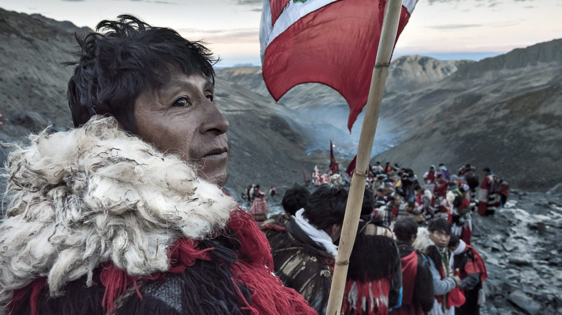 """""""Around 80,000 pilgrims descend upon the Sinakara Valley in the Peruvian Andes to celebrate the festival of Qoyllur Rit'i – a mixture of Inca and Catholic traditions. During the final night, bands of Ukukus head up to the holy glaciers at an altitude of 5,600m to perform initiation rituals. At dawn they descend back into the valley, carrying large crosses on their backs."""" (Christopher Roche)"""