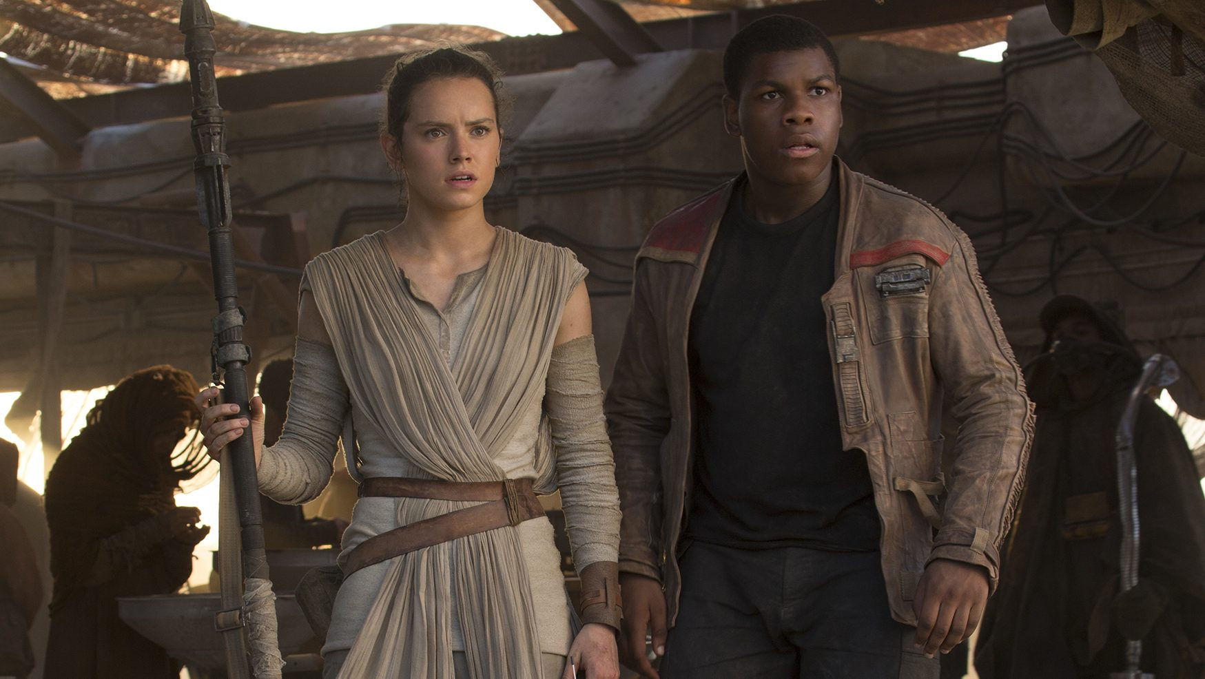 Rey, played by Daisy Ridley, and Finn, played by John Boyega, in a scene from 'The Force Awakens.' (David James/Lucasfilm)