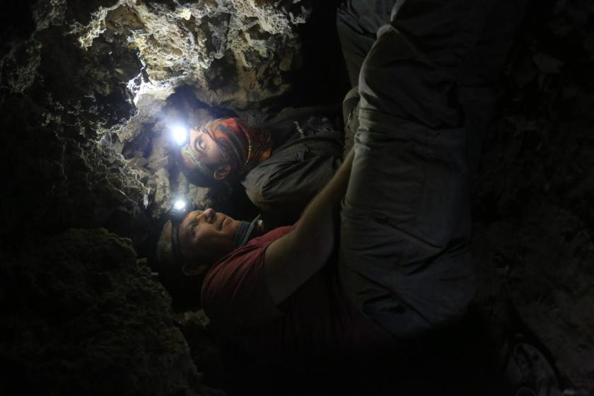 Archaeologists Oren Gutfeld and Ahiad Ovadia, from the Hebrew University's Institute of Archaeology, survey a cave that once contained Dead Sea Scrolls. (Casey L. Olson and Oren Gutfeld)