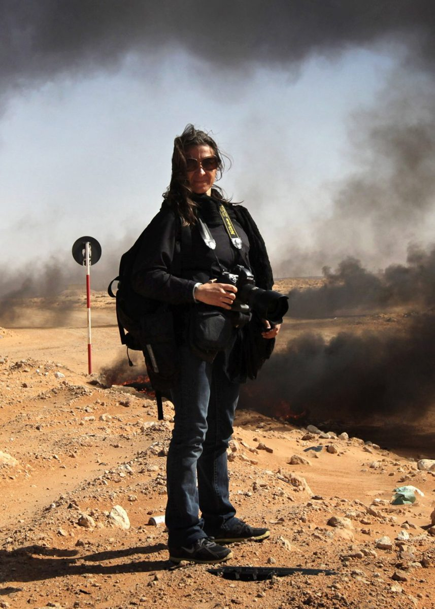 New York Times photographer Lynsey Addario stands near the frontline during a pause in the fighting March 11, 2011 in Ras Lanuf, Libya. (John Moore/Getty Images)