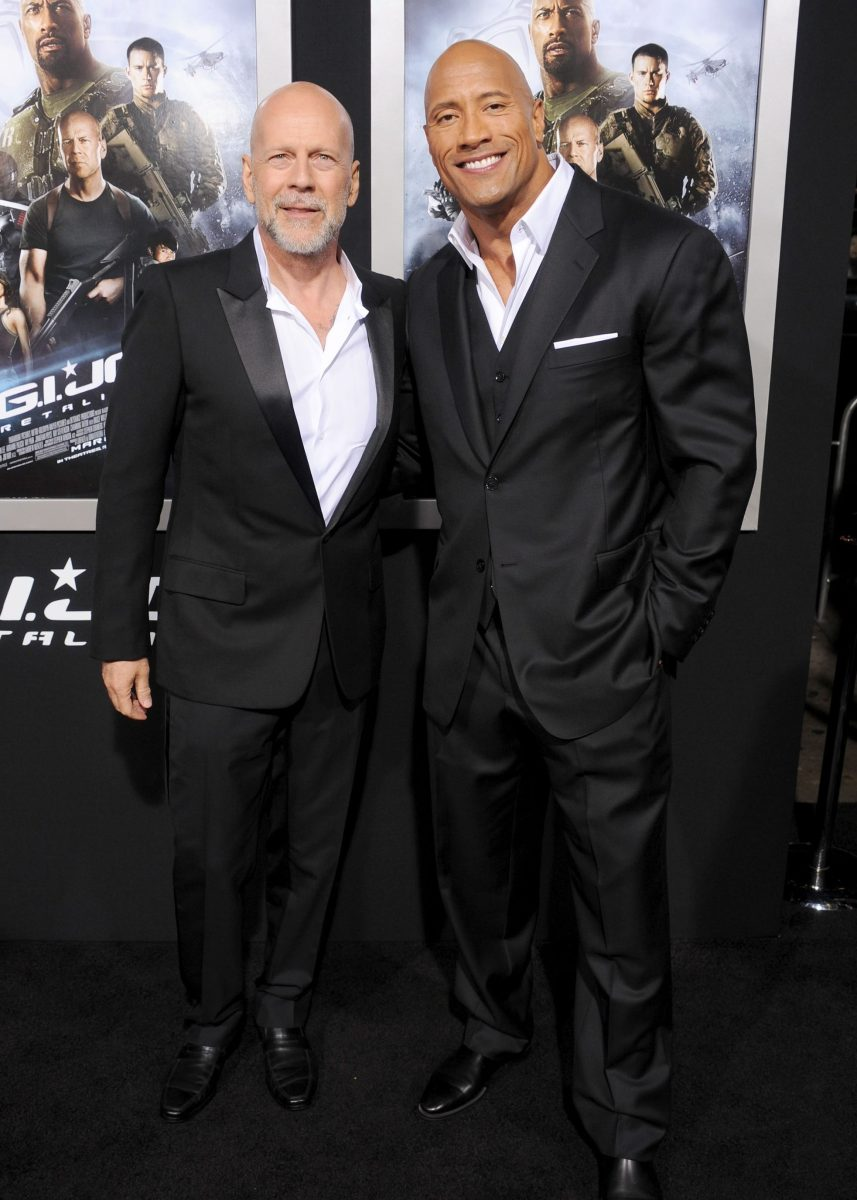 """HOLLYWOOD, CA - MARCH 28: Actors Bruce Willis and Dwayne Johnson arrive at the """"G.I. Joe: Retaliation"""" Los Angeles premiere at TCL Chinese Theatre on March 28, 2013 in Hollywood, California.  (Photo by Gregg DeGuire/WireImage)"""